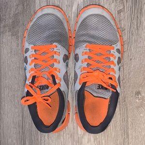 Neon-orange Nike Free 5.0 (slight wear/tear)